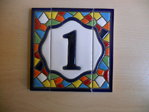 7.5 cm high (1 tile+ 2 borders). Address house tiles of letters and numbers in Gaudí style.