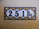7.5 cm high (4 tiles+ 2 borders). Address house tiles of letters and numbers in Gaudí style.