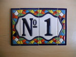 7.5 cm high (2 tiles+ 2 borders). Address house tiles of letters and numbers in Gaudí style.